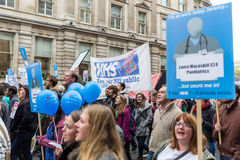 Thousands Junior doctors protest in London. LONDON, UK - OCTOBER 17, 2015: Thousands Junior doctors marching in London streets to campaign against NHS contract Royalty Free Stock Image