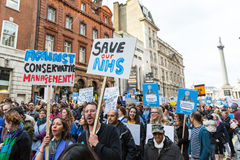 Thousands Junior doctors protest in London. LONDON, UK - OCTOBER 17, 2015: Thousands Junior doctors marching in London streets to campaign against NHS contract Royalty Free Stock Photography