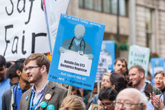 Thousands Junior doctors protest in London. LONDON, UK - OCTOBER 17, 2015: Thousands Junior doctors marching in London streets to campaign against NHS contract Royalty Free Stock Photos
