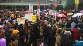 Thousands march against TPP trade agreement in Auckland New Zealand stock video
