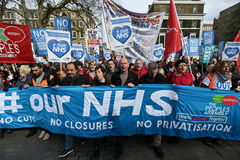 Thousands March in Support of the NHS. London, UK - March 4, 2017: Protesters march through central London during a demonstration in support of the NHS Stock Photography