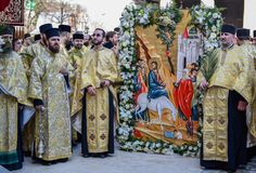 Thousands of Orthodox priests on the street celebrate Orthodox Palm Sunday in Romania. Thousands of Orthodox priests on the street holding palm fronds and stock photo