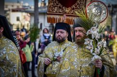 Thousands of Orthodox priests on the street celebrate Orthodox Palm Sunday in Romania. Thousands of Orthodox priests on the street holding palm fronds and stock photos