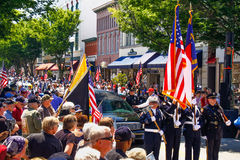 Thousands at Parade Honor Fallen Soldier. An honor guard of local firefighters and police officers lead a procession to welcome home SFC Donnie Shue, U.S. Army stock photo