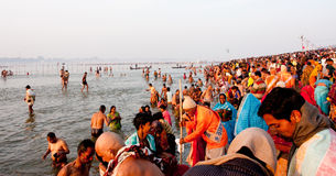 Thousands of people come to holy water. In the confluence of Ganges and Yamuna during the biggest festival in the world, Kumbh Mela, in Allahabad, India Royalty Free Stock Images