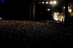 Thousands of People Crowd at night Concert Stock Image