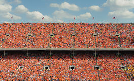Thousands of people dressed in orange Stock Photo