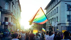 Thousands of people gathered to celebrate begining of LGBT Honor week. Participants wave rainbow flag and celebrate in the annual stock image
