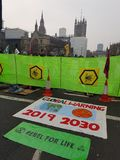 The Extinction Rebellion: Climate protesters in Central London. Thousands of people joined protests across central London with the Extinction Rebellion as royalty free stock photo