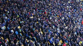 Thousands of people watching football match at stadium, big sporting event