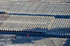 Thousands of pipes on the barge and man royalty free stock photo
