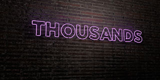 THOUSANDS -Realistic Neon Sign on Brick Wall background - 3D rendered royalty free stock image Stock Photography