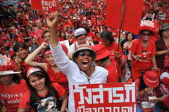 Thousands of Red Shirts Protest in Bangkok. Around 20,000 Red shirt protesters gather at a rally in the city centre on May 19, 2013 in Bangkok, Thailand. The Royalty Free Stock Photos