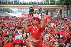 Thousands of Red Shirts Protest in Bangkok. Around 20,000 Red shirt protesters gather at a rally in the city centre on May 19, 2013 in Bangkok, Thailand. The Royalty Free Stock Photo
