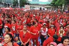 Thousands of Red Shirts Protest in Bangkok. Around 20,000 Red shirt protesters gather at a rally in the city centre on May 19, 2013 in Bangkok, Thailand. The Stock Photos