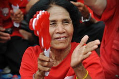Thousands of Red Shirts Protest in Bangkok. A protester joins a 20,000 strong red shirt rally in the city centre on May 19, 2013 in Bangkok, Thailand. The Royalty Free Stock Photo