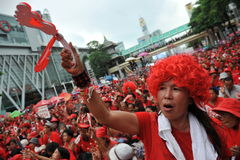 Thousands of Red Shirts Protest in Bangkok. A protester joins a 20,000 strong red shirt rally in the city centre on May 19, 2013 in Bangkok, Thailand. The Stock Photo
