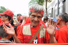 Thousands of Red Shirts Protest in Bangkok. A protester joins a 20,000 strong red shirt rally in the city centre on May 19, 2013 in Bangkok, Thailand. The Royalty Free Stock Photography
