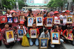 Thousands of Red Shirts Protest in Bangkok. Relatives of red shirt protesters killed during the military's 2010 crackdown on anti-government protests gather at a Stock Photography