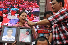Thousands of Red Shirts Protest in Bangkok. Relatives of red shirt protesters killed during the military's 2010 crackdown on anti-government protests gather at a Stock Photo
