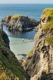 Tourists visiting Carrick-a-Rede Rope Bridge in County Antrim of Northern Ireland. Thousands of tourists visiting Carrick-a-Rede Rope Bridge in County Antrim of royalty free stock photography