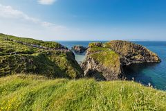 Tourists visiting Carrick-a-Rede Rope Bridge in County Antrim of Northern Ireland. Thousands of tourists visiting Carrick-a-Rede Rope Bridge in County Antrim of royalty free stock photos