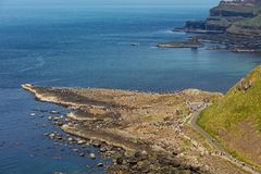 Thousands of tourists visiting Giant`s Causeway in County Antrim of Northern Ireland stock photography