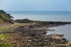 Thousands of tourists visiting Giant`s Causeway in County Antrim of Northern Ireland. A World Heritage Site by UNESCO containing about 40000 interlocking stock image