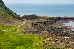 Thousands of tourists visiting Giant`s Causeway in County Antrim of Northern Ireland stock image