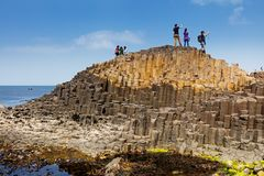 Thousands of tourists visiting Giant`s Causeway in County Antrim of Northern Ireland. A World Heritage Site by UNESCO containing about 40000 interlocking royalty free stock photos