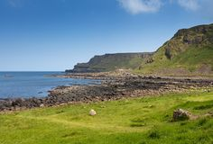 Thousands of tourists visiting Giant`s Causeway in County Antrim of Northern Ireland. A World Heritage Site by UNESCO containing about 40000 interlocking royalty free stock photo