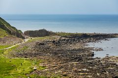Thousands of tourists visiting Giant`s Causeway in County Antrim of Northern Ireland royalty free stock images