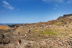 Thousands of tourists visiting Giant`s Causeway in County Antrim of Northern Ireland. A World Heritage Site by UNESCO containing about 40000 interlocking royalty free stock photography