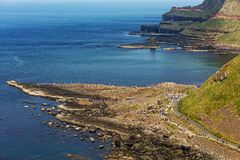 Thousands of tourists visiting Giant`s Causeway in County Antrim of Northern Ireland. A World Heritage Site by UNESCO containing about 40000 interlocking stock photos