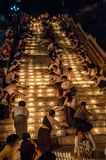 Thousands of votive candles during the Festival of Lights. Kyaiktiyo, Myanmar - oct 2012 : Pilgrims light thousands of votive candles in front of the Golden Rock Royalty Free Stock Images