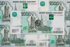 On thousandth Russian rubles banknote is one ruble coin. On thousandth of Russian rubles banknote is one ruble coin stock image