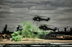Thow Helicopters over a beach Stock Image