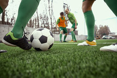Thq legs of soccer football player Stock Image