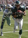 Thrash. 9/22/2002:Philadelphia Eagles receiver James Thrash hauls in a pass for a touchdown the third quarter in front of Dallas Cowboys cornerback Duane Royalty Free Stock Image