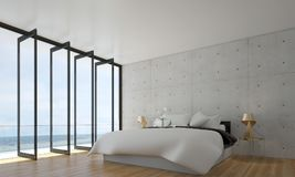 The interiors design idea of minimal bedroom and concrete wall and sea view. Thre bedroom interior design idea Royalty Free Stock Photo