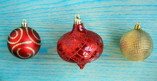 Thre Christmas balls  red one gold Stock Image