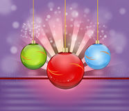 Thre christmas bauble. Three hanging colored christmas bauble Royalty Free Stock Images