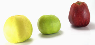 Thre different apples on a white background Royalty Free Stock Images