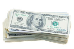 Thre högar av dollarpengar Arkivbilder