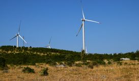 Three wind turbines, blue sky lanscape Royalty Free Stock Photo