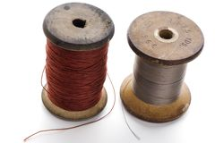 Thread. Couple of spools of thread on white Royalty Free Stock Images