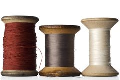 Thread. Three spools of thread on white Royalty Free Stock Image