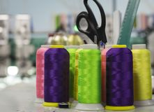 A thread of acidic shades on the cones facing the embroidery machine.  royalty free stock image
