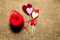 Thread ball with sweet hearts  isolated on fabric material Royalty Free Stock Photography