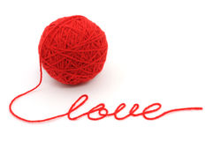 Thread ball with word 'love' Royalty Free Stock Photo